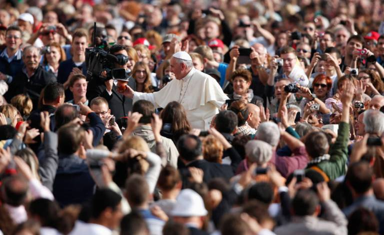 Pope Francis waves as he arrives to lead the general audience in Saint Peter's Square at the Vatican